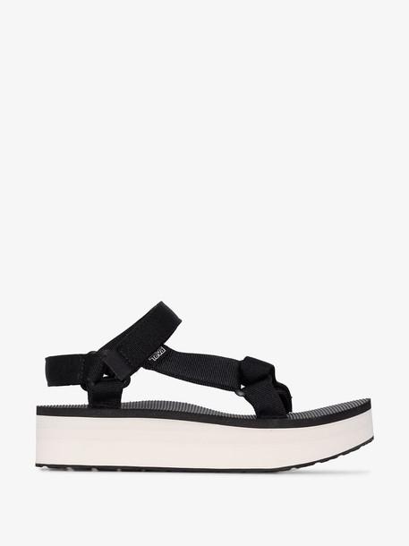 Teva black and white universal platform sandals