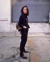 jumpsuit,black jumpsuit,topshop,brown boots,cowboy boots,brown bag,louis vuitton bag,backpack