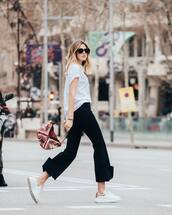bag,shoulder bag,white sneakers,etruria skirt,black pants,flare pants,white t-shirt