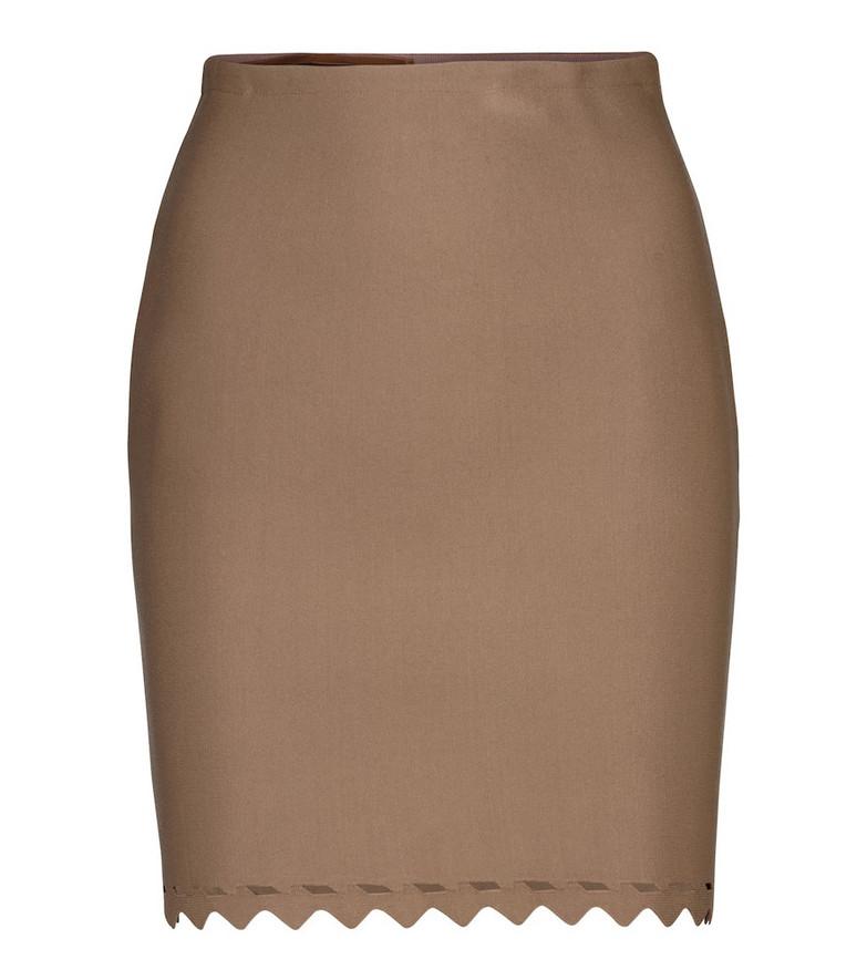 Alaïa Laser-cut stretch-knit miniskirt in beige