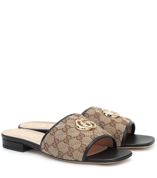 Gucci GG leather-trimmed canvas slides in brown