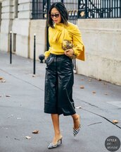 sweater,yellow sweater,black shorts,leather shorts,mules,bag