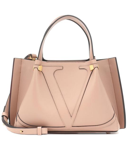Valentino Garavani VLOGO Escape Small leather shopper in beige