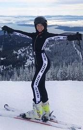 jumpsuit,skiing,celebrity,celebrity style,snow,black,white