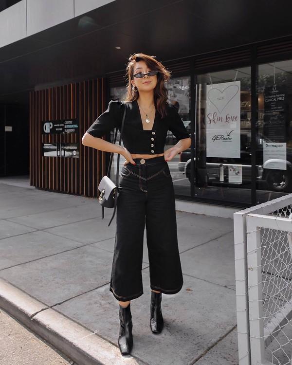top black crop top black pants wide-leg pants cropped pants black boots ankle boots black bag