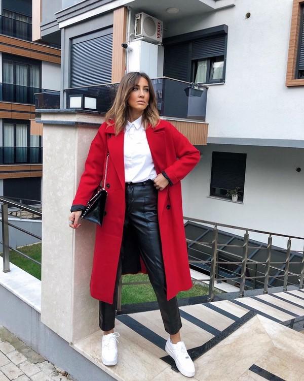 coat red coat long coat white sneakers black leather pants white shirt black bag