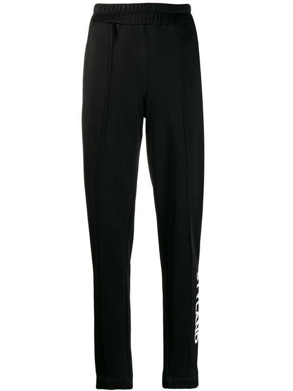 Styland logo print track pants in black