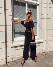 bag,black bag,handbag,black sandals,off the shoulder,black jumpsuit