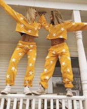 pants,yellow stars,jumpsuit,sweater,bag,sweatpants,jeans,yellow,stars,yellow and white stars,shirt