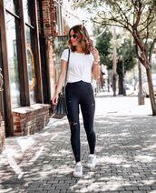 pants,black leggings,white sneakers,white t-shirt,black bag