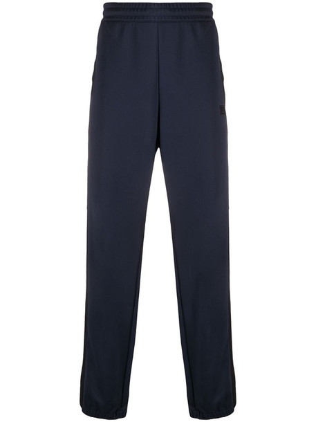 Acne Studios side stripe loose-fit track pants in blue