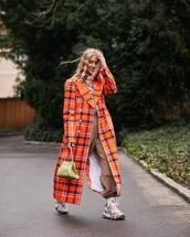 coat,long coat,orange coat,plaid,double breasted,sneakers,pants,socks,handbag,top