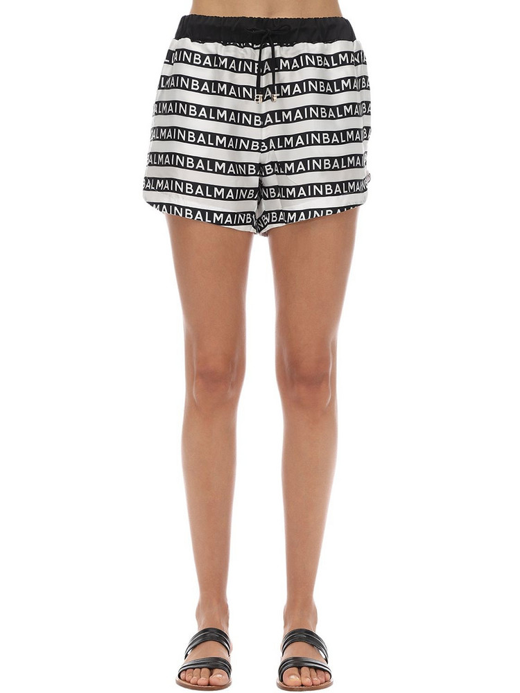 BALMAIN All Over Logo Silk Satin Shorts in black / white