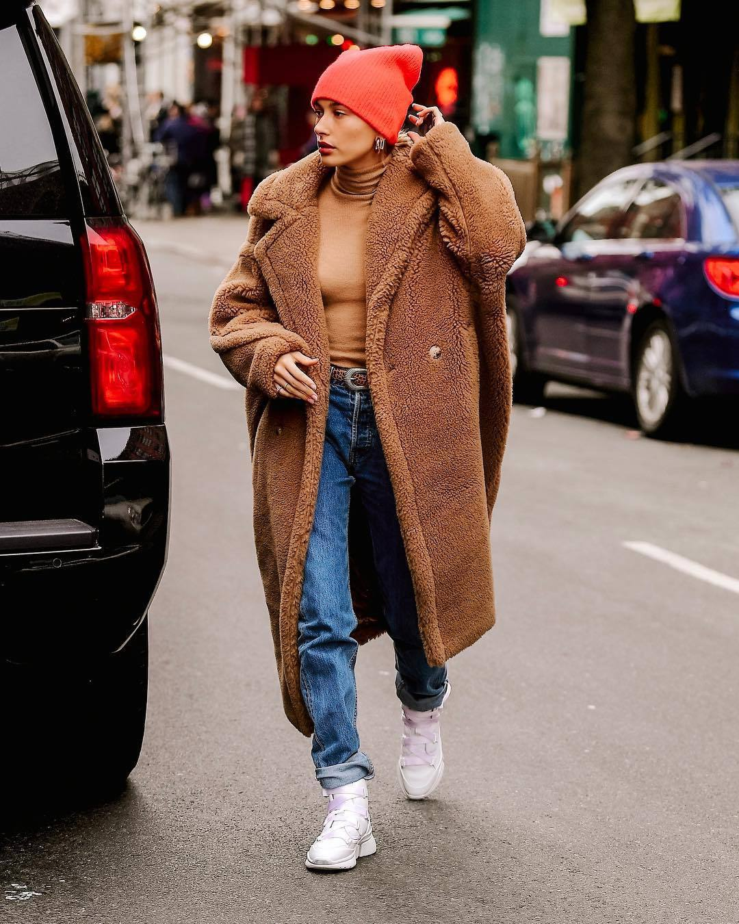 coat faux fur coat long coat white sneakers denim jeans turtleneck knit hat hailey baldwin belt celebrity