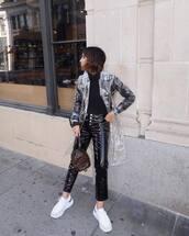 pants,black leather pants,black vinyl pants,white sneakers,trench coat,backpack,louis vuitton bag,black turtleneck top