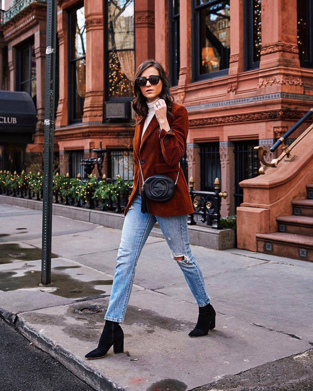 jacket blazer double breasted black boots ankle boots heel boots ripped jeans straight jeans high waisted jeans black bag gucci bag white turtleneck top black sunglasses