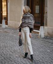 jeans,flare jeans,white jeans,black boots,heel boots,black bag,black sweater,scarf