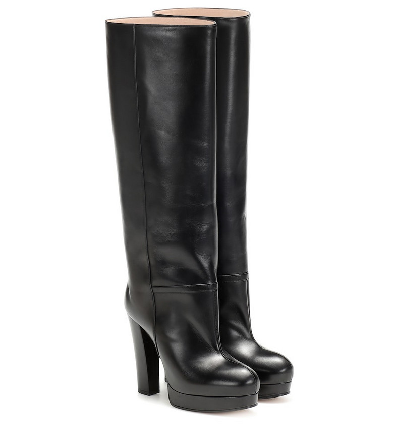 Gucci Leather platform boots in black