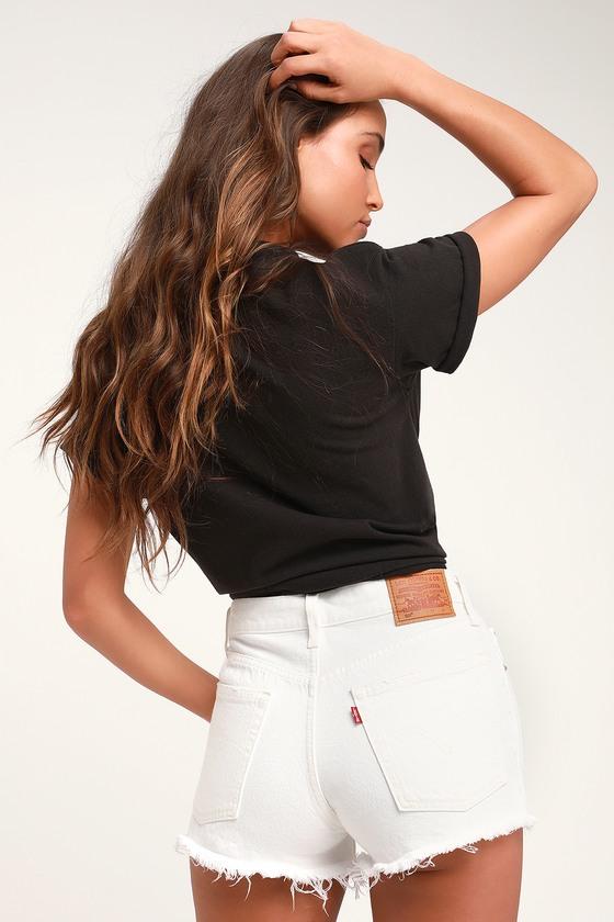 501 Mid Rise White Distressed Denim Shorts