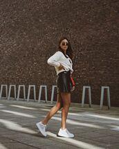 skirt,black leather skirt,mini skirt,white sneakers,white sweater,bag