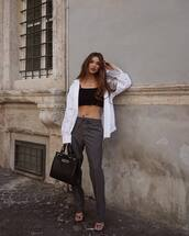 bag,black bag,pants,grey pants,top,shirt,sandals