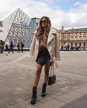 jacket,shearling jacket,aviator jacket,black boots,black skirt,mini skirt,sweater,black bag