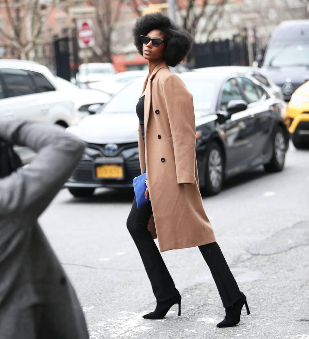 coat beige coat flare pants black pants black boots black top bag