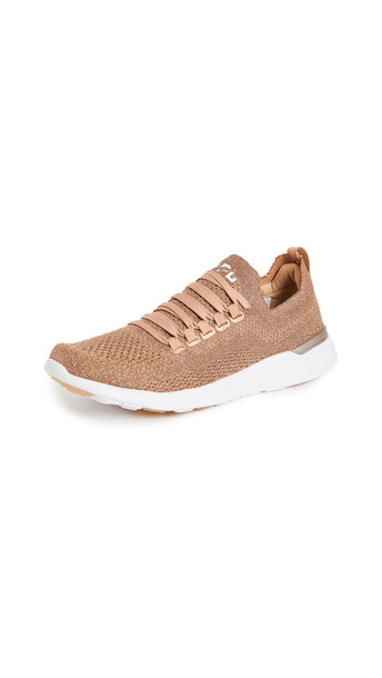 APL: Athletic Propulsion Labs Techloom Breeze Sneakers in gold / rose / white