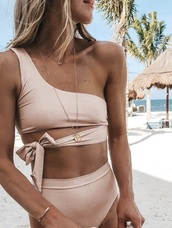 swimwear,one shoulder,tie swimsuit,dusty pink swimsuit,dusty pink,wrap swimsuit,pink swimwear,high waisted,asymmetric swimsuit