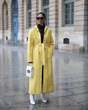 coat,leather coat,yellow coat,long coat,white boots,heel boots,white bag,handbag,leather,white turtleneck top,black dress,turtleneck dress,tights