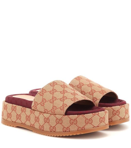 Gucci Original GG platform sandals in beige