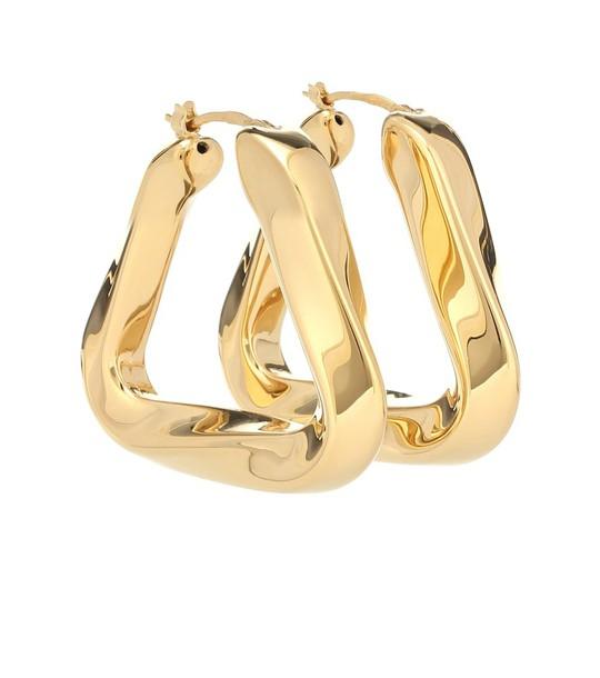 Bottega Veneta Large hoop earrings in gold