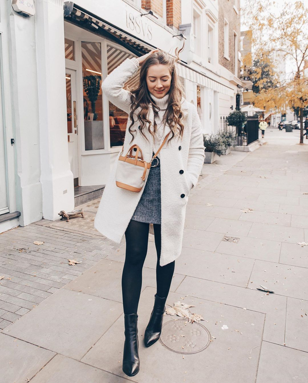 bag tote bag ankle boots black boots tights mini skirt turtleneck sweater white sweater white coat
