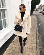 coat,faux fur coat,white coat,black boots,lace up boots,skinny pants,black pants,ysl bag,black bag,black turtleneck top