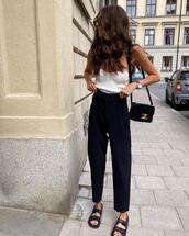 shoes,flat sandals,black pants,straight pants,white top,chanel bag