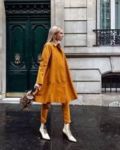 coat,yellow coat,elegant,mustard,straight pants,white booty shorts,lace up boots,handbag,white turtleneck top