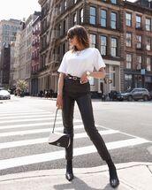 pants,black pants,black leather pants,skinny pants,black boots,chanel bag,white t-shirt