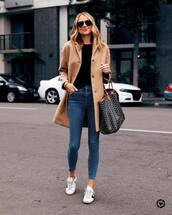 jeans,skinny jeans,white sneakers,camel coat,shoulder bag,black sweater,sunglasses