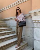 top,striped shirt,loafers,wide-leg pants,black bag