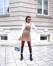 dress,mini dress,black boots,combat boots,platform shoes,socks,tights,pvc,shoulder bag,white sweater
