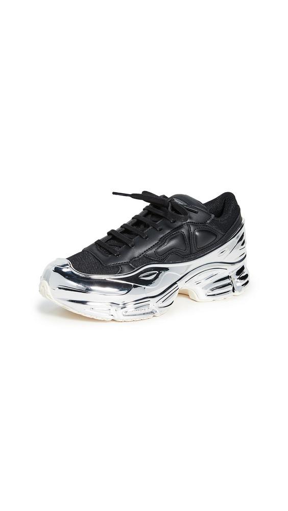 adidas Raf Simons Ozweego Sneakers in black / metallic / silver