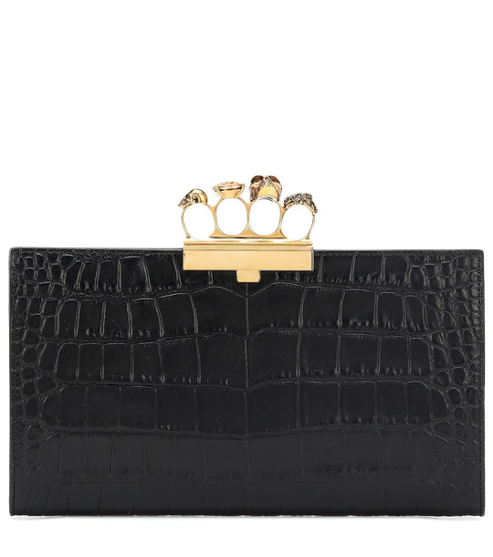 Alexander McQueen Skull Four-Ring leather clutch in black