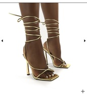 shoes,gold,heels,strappy heels,stilletoes,gold shoes,gold heels