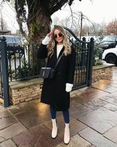 coat,black coat,white boots,ankle boots,skinny jeans,white sweater,ysl bag,black bag