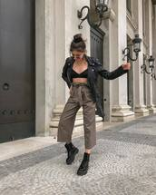 pants,high waisted pants,wide-leg pants,black boots,DrMartens,black leather jacket,black bralette