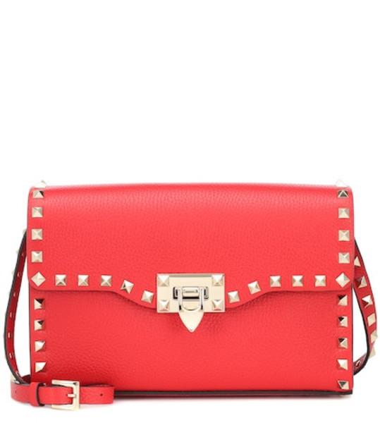 Valentino Garavani Rockstud Small leather shoulder bag in red