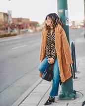 top,blouse,patent shoes,black boots,jeans,ysl bag,black bag,faux fur coat