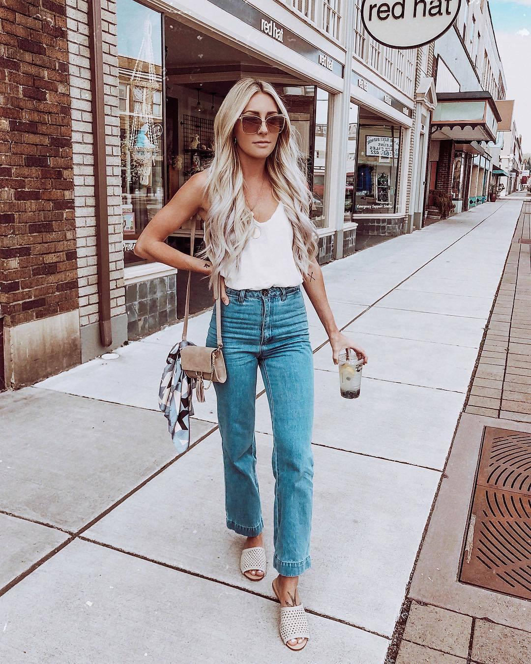 jeans high waisted jeans slide shoes white top tank top v neck shoulder bag