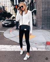 sweater,white sweater,knitted sweater,white sneakers,black skinny jeans,cropped jeans,black bag,crossbody bag,sunglasses,streetstyle