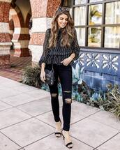 top,black blouse,black skinny jeans,ripped jeans,black sandals,black bag